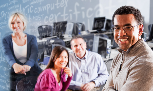 Teacher and students in computer training lab